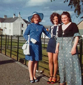 Pictured in the blue dress with Mary Carson & May Maxwell