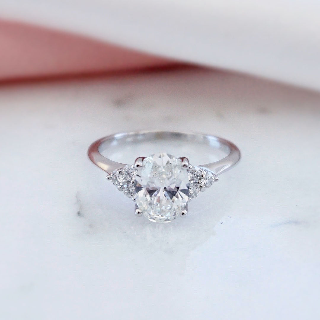 Oval diamond engagement ring with accent stones