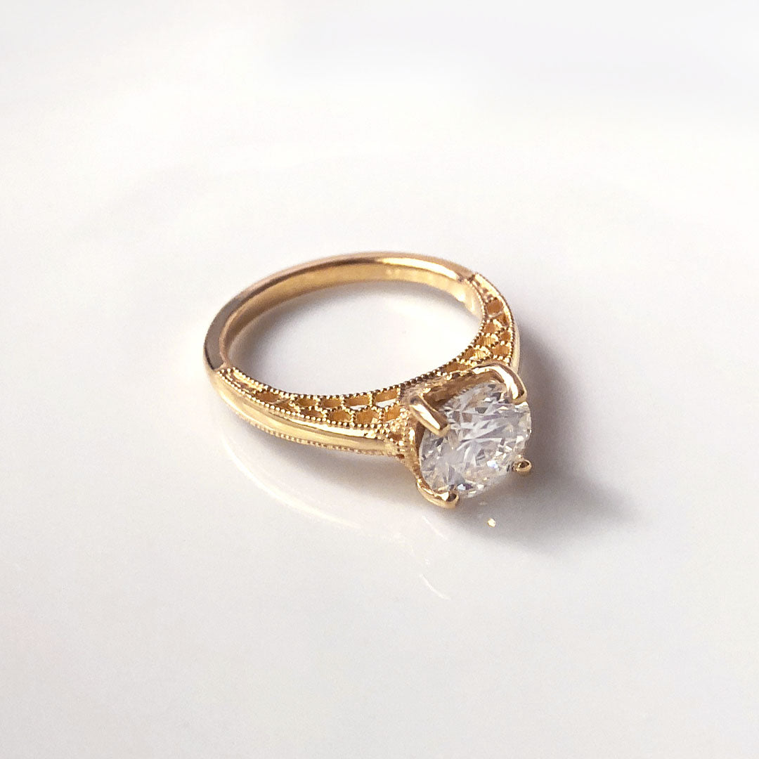 Family heirloom inspired solitaire diamond engagement ring