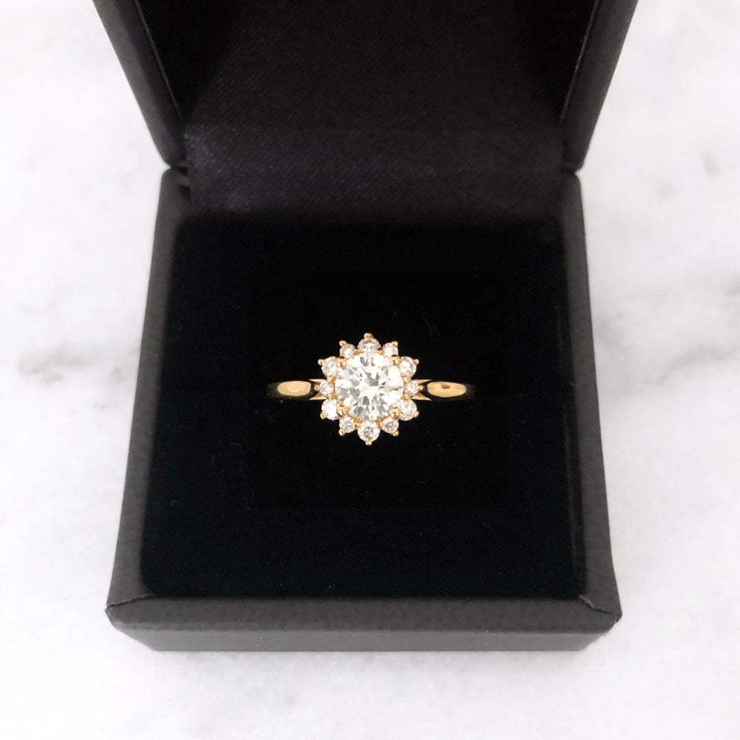 Floral inspired halo-style round brilliant diamond engagement ring