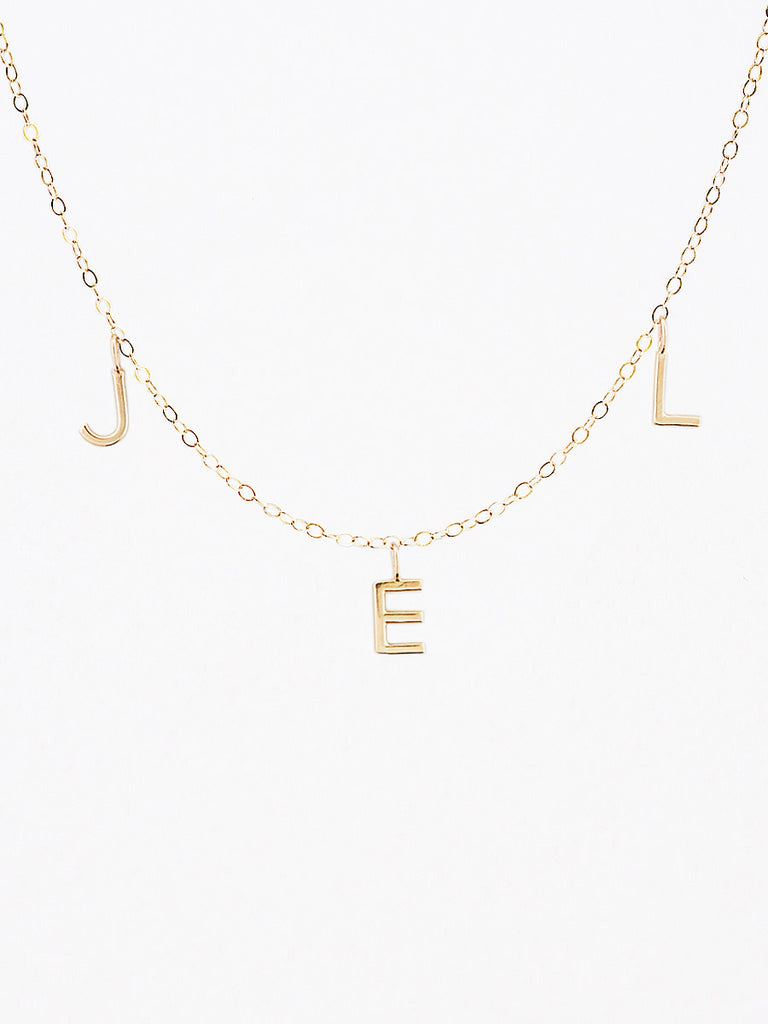 14k gold horizontal mini letter charm necklace