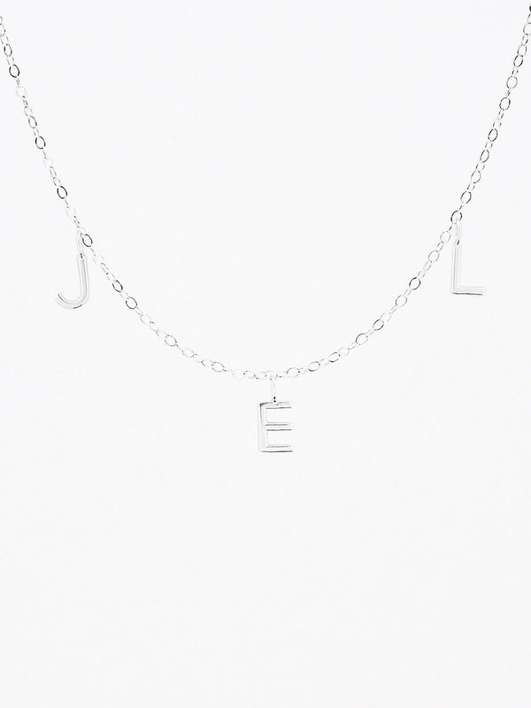 Sterling silver horizontal mini letter charm necklace