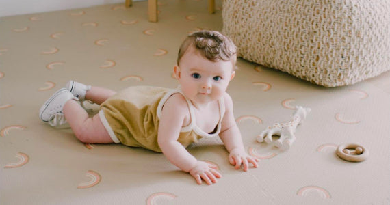 A baby having tummy time on the floor