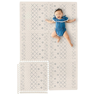 Infant Laying on a Carter Mudcloth Tan Neutral Baby Play Mat