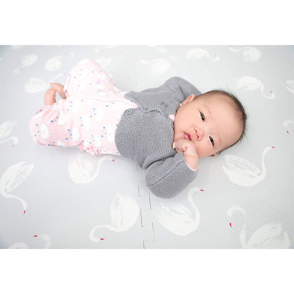 Infant Laying on Swan Grey Foam Mats