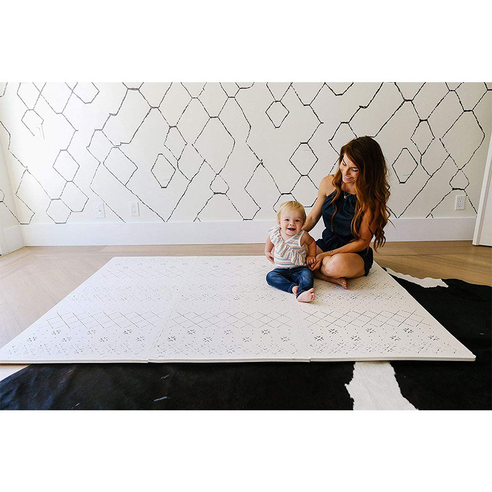 Woman and Baby Sitting on a Carter Mudcloth Tan Neutral Foam Playmat