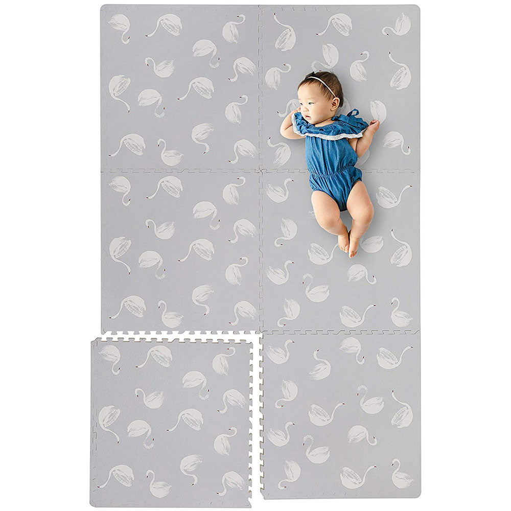 Baby Laying on Swan Grey Foam Mats