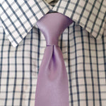 purple tie on check shirt