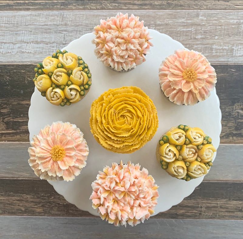 Peach, Golden Yellow, and White Flower Cupcakes