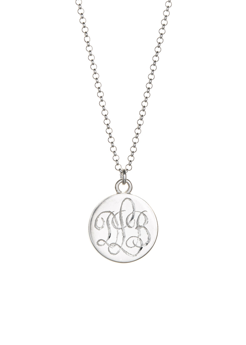Hand engraved sterling silver monogram on back of lace keepsake necklace.