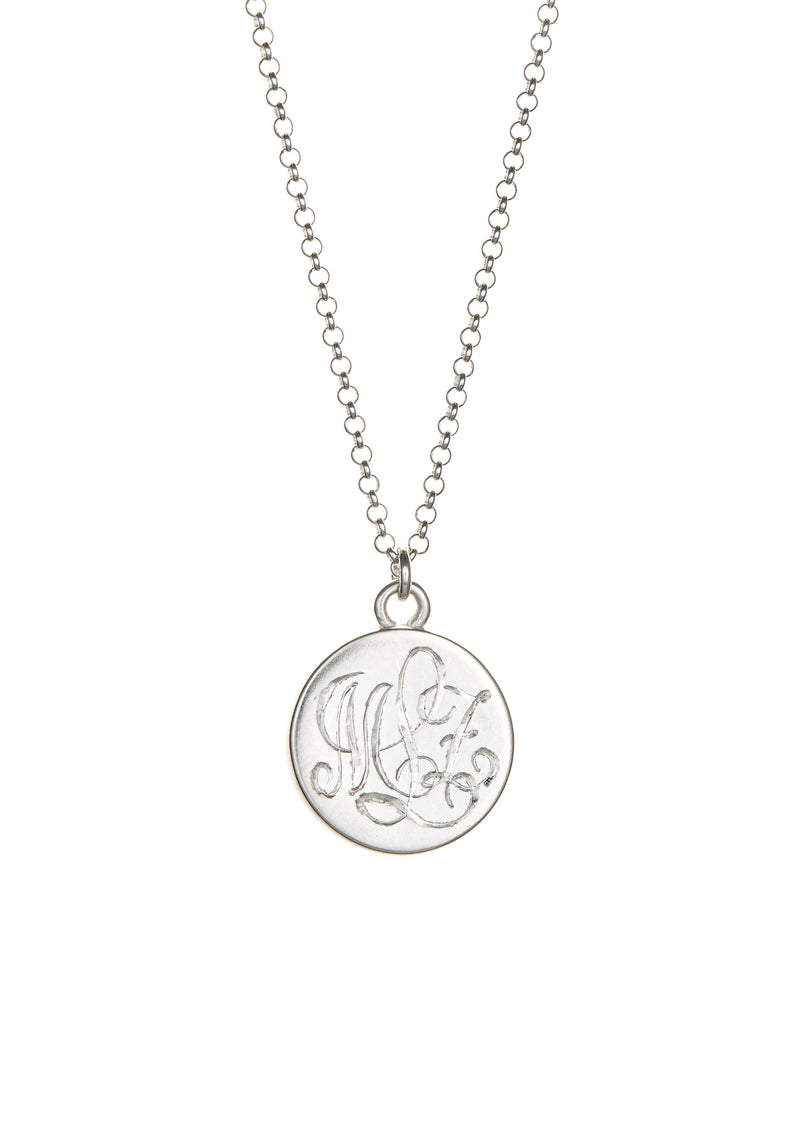 Hand engraved sterling silver monogram on back of lace keepsake pendant.