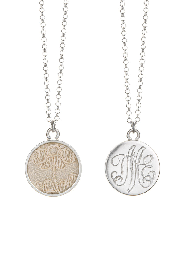 Lace keepsake necklace with hand engraved monogram on sterling silver pendant.