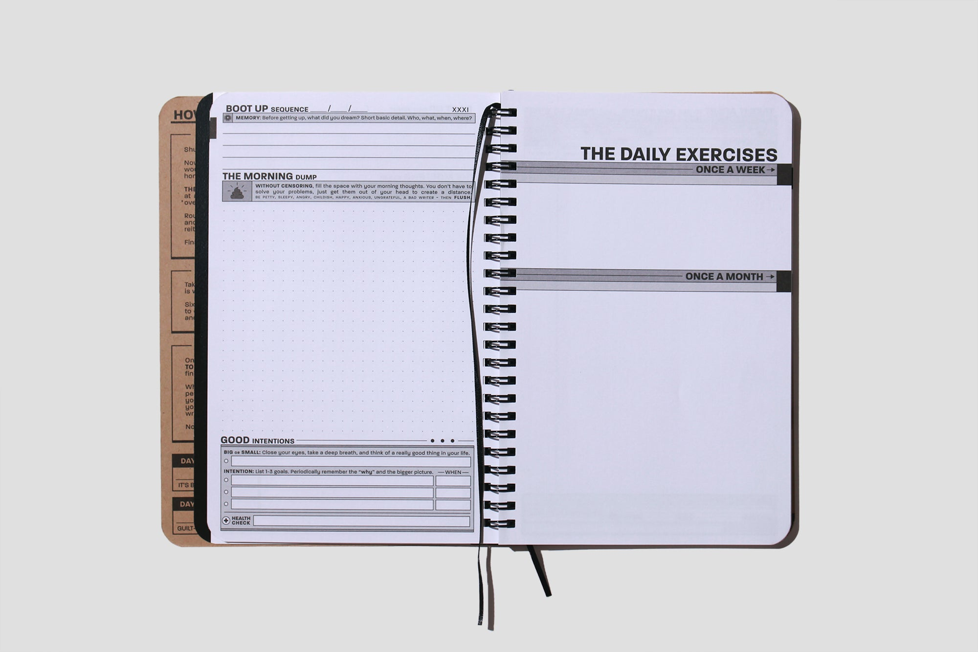 The Daily Exercises open book with ribbon and wire binding