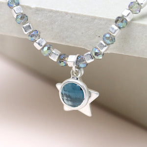 Silver cub bead and blue crystal bracelet with star