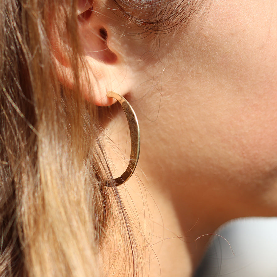Worn gold irregular hammered open hoop earrings