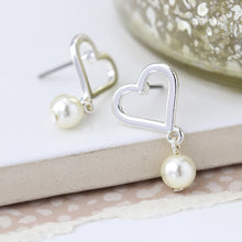 Load image into Gallery viewer, Silver plated heart and ivory pearl stud earrings.