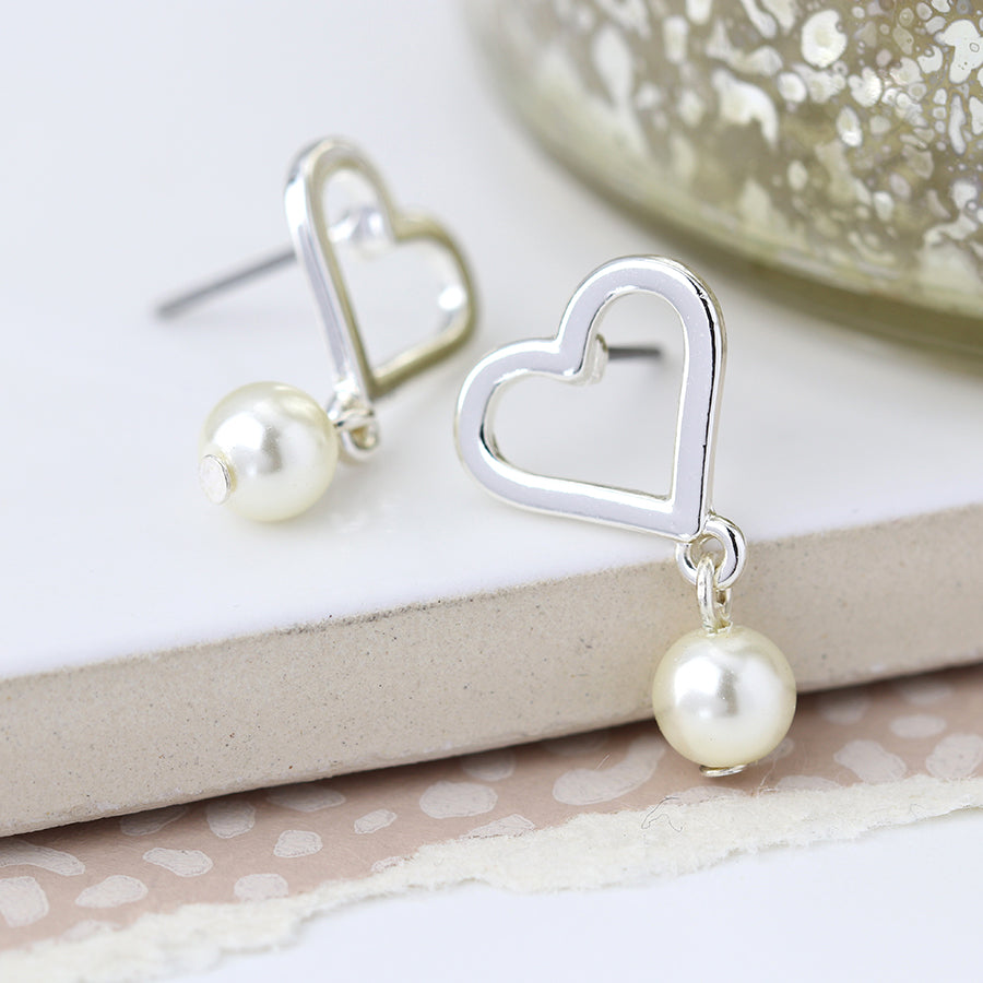Silver plated heart and ivory pearl stud earrings.
