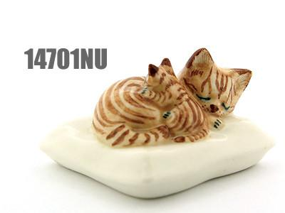Ceramic Cats on Cushion