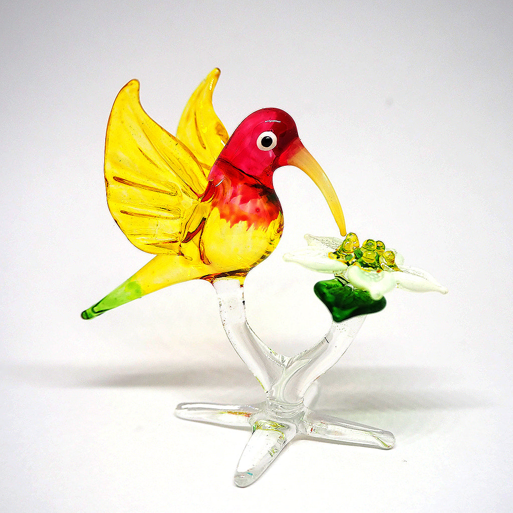 Yellow Humming Bird With Flower