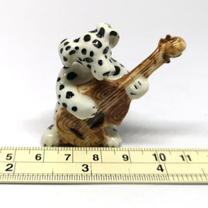 Dalmatian Dog Playing Cello