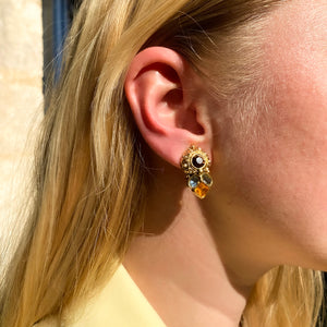 Golden Agatha earrings in floral shape with colored rhinestones by Gigi Paris
