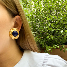 Load the image in the gallery, Imposing round golden earrings with blue cabochon and wave details from CHEZ GIGI PARIS