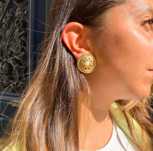 Round golden hammered pearl rope style earrings with blue applats by Gigi Paris