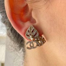 Load the image in the gallery, Chanel silver CC logo faux diamonds and leaf earrings from GIGI PARIS