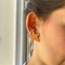 Load the image in the gallery, Chanel earrings in the shape of a star CC logo salmon color
