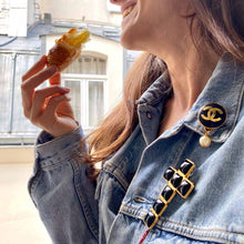Load the image in the gallery, Gripoix brooch for Chanel imposing in the shape of a golden cross and black stones from GIGI PARIS