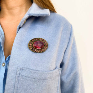 Brass and pink crystal brooch