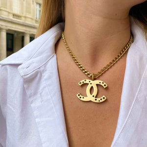 Chanel brushed gold CC logo necklace with stars