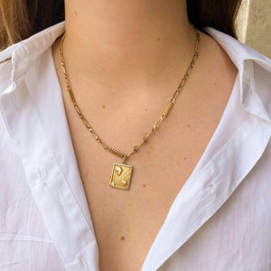 Golden alternating horse mesh necklace with heart and sun medallion by Gigi Paris