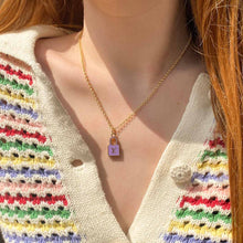 Load the image in the gallery, Upcycled Louis Vuitton mauve padlock necklace from Gigi Paris