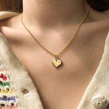 Load image into Gallery viewer, Upcycled Louis Vuitton golden heart necklace by Gigi Paris