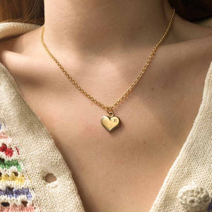 Upcycled Louis Vuitton golden heart necklace from Gigi Paris