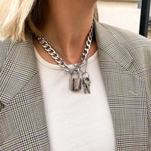 Load the image in the gallery, Upcycled Louis Vuitton silver padlock necklace from GIGI PARIS