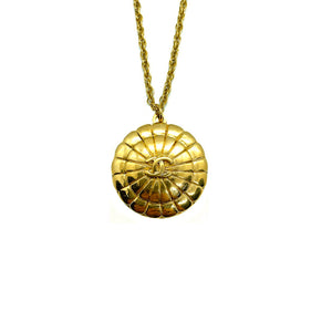 Upcycled Chanel golden necklace in the shape of a shell from GIGI PARIS