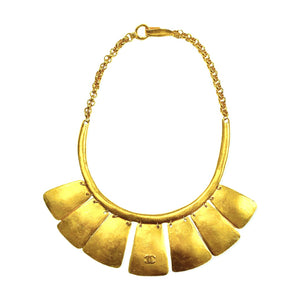 Chanel ethnic gold-plated chocker in an arc with 7 dangling plates and CC logo