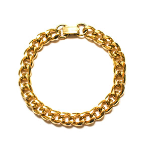 Gold curb chain bracelet watch style clasp