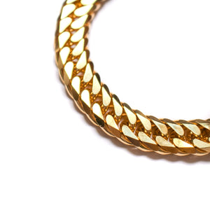 Thick golden chain bracelet with curb link