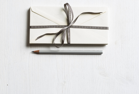 Atl Text: letter with ribbon and pencil handwritten note