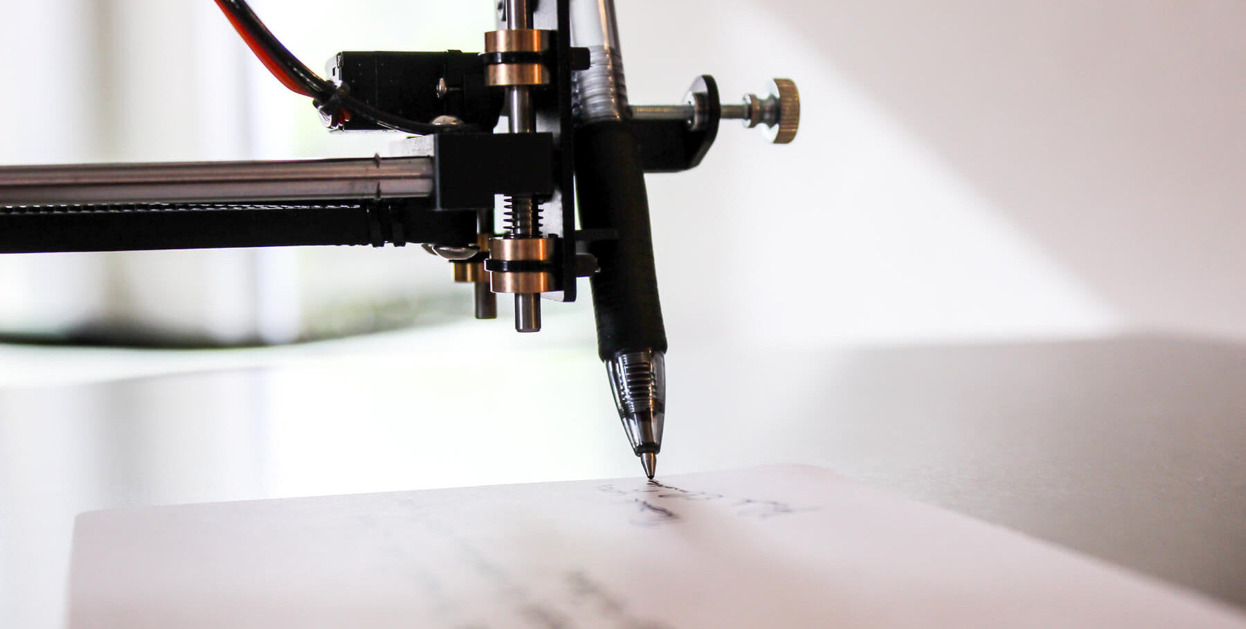 handwriting machine writing on white paper