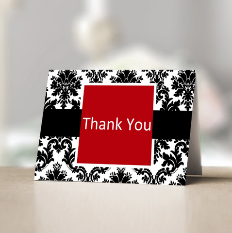 Thank you card with red, black and white design.