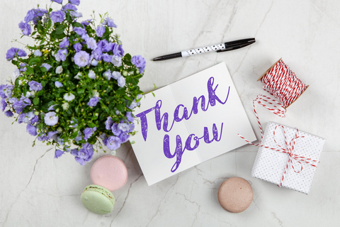 ALT: thank you card with flowers, macaroons, pen, and present