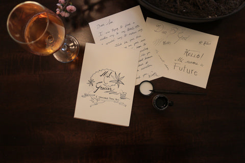 Greetings handwritten letters spread out on a desk