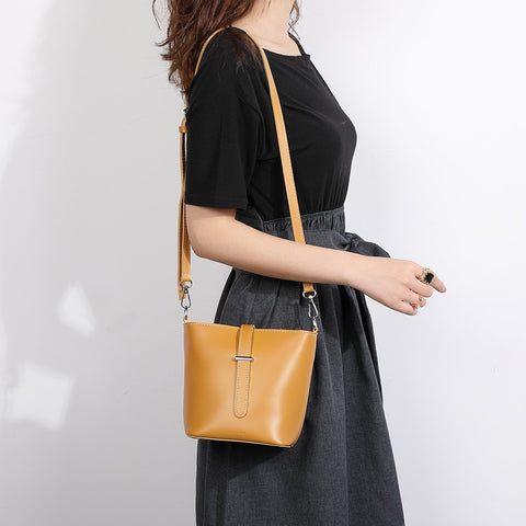 Strapped PU leather bucket bag
