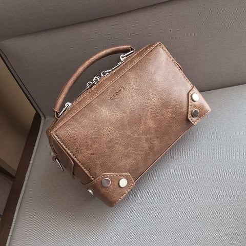 Studded corner marble-effect creased PU leather bag