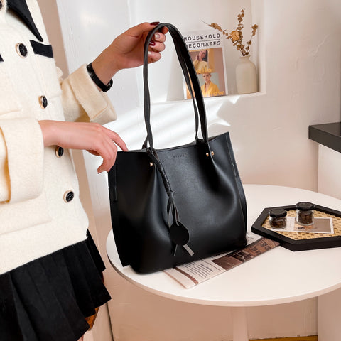 Rope charm studded PU leather tote bag