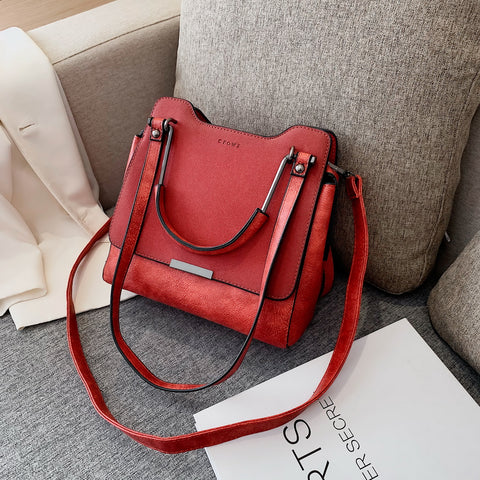 Front flap metal handle multi-strap zipped PU leather crossbody bag